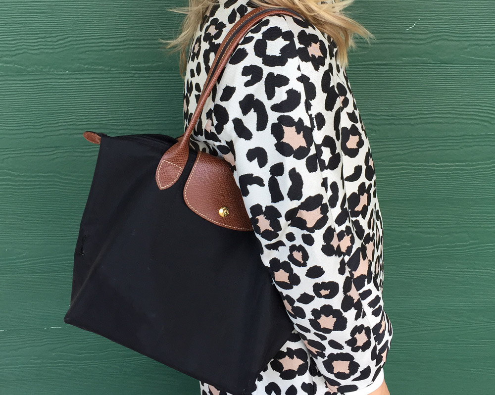 Black longchamp le pliage tote with animal print jacket